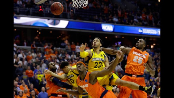 Syracuse and Marquette players fight for the rebound on March 30.