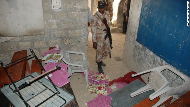 A Pakistani paramilitary soldier looks at a classroom following an attack by gunmen in Karachi on March 30.