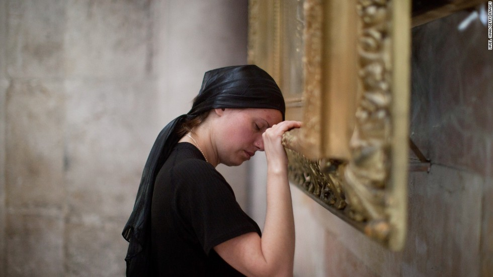 A Christian worshipper prays at the Church of the Holy Sepulchre in Jerusalem on Friday.