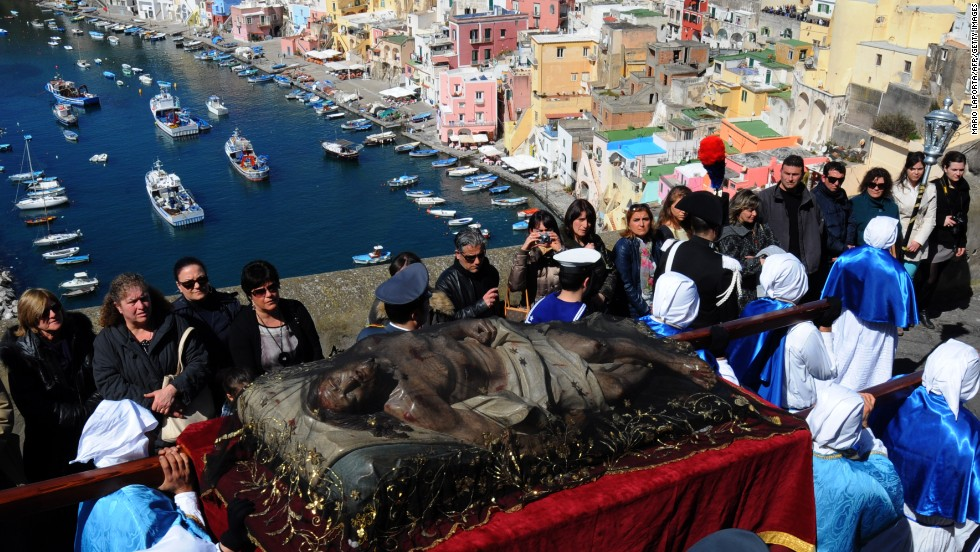 Penitents carry a Christ statue during a procession on the island of Procida off the coast of Italy on Friday.