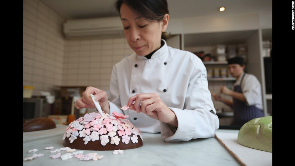 Head chocolatier Chika Watanabe decorates a limited edition Easter egg in the Melt chocolate shop in London on Thursday.