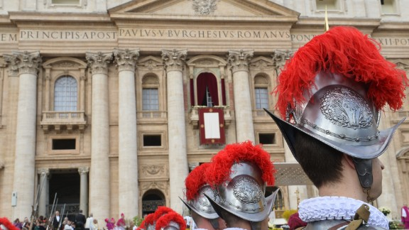 Swiss guards stand in St. Peter's Square before the Easter celebrations at the Vatican on Sunday, March 31. Pope Francis led his first Easter Sunday celebrations with a Mass marking the holiest day in the Christian calendar.