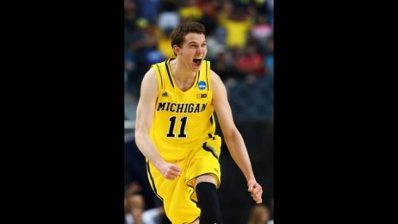 Nik Stauskas of Michigan celebrates after shooting a three-pointer.