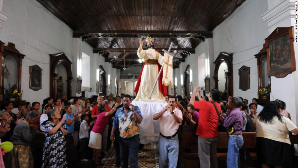 Catholic faithful participate in the Easter Sunday procession in Tegucigalpa, Honduras, on March 31.