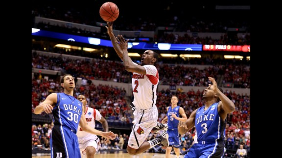 Russ Smith of the Louisville Cardinals drives for a shot attempt against Seth Curry, left, and Tyler Thornton of the Duke Blue Devils on Sunday, March 31, in Indianapolis. Louisville beat Duke 85-63. Check out the action from the fifth round of the 2013 NCAA tournament and look back at the NCAA tournament Sweet 16.
