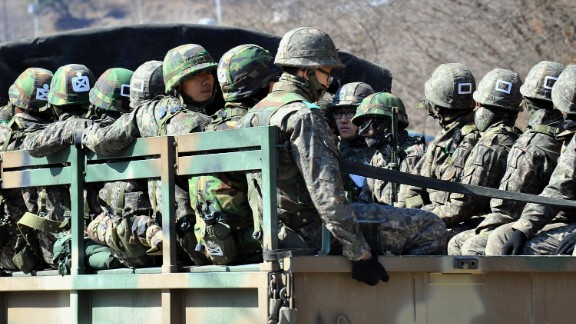 South Korean soldiers ride on a military truck in Paju on Friday, March 29.