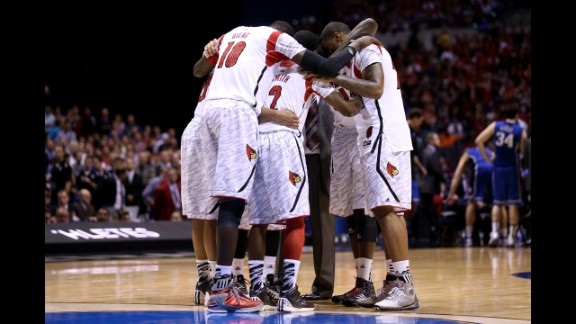 The Cardinals huddle up on the court.