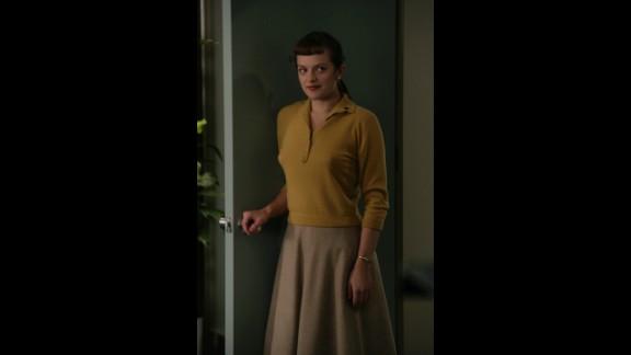 Elisabeth Moss plays Peggy Olson, who starts the show as a secretary.