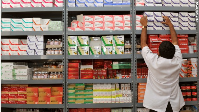 An Indian pharmacist pulls out a box of medicines from a shelf at a Generic Drug Store at the Victoria Hospital in Bangalore on June 28, 2012.