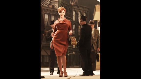 """It's hard not to think of 1960s office attire without conjuring images of the flawlessly tailored cast of """"Mad Men."""" Here, actress Christina Hendricks' hourglass figure is emphasized with a streamlined dress fitted to perfection. """"In the 1960s you have a continuation of the 1950s tailored look -- but breaking it up with more color,"""" said Arnold."""