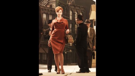 Joan attracts plenty of male attention in a flattering dress in season 3.
