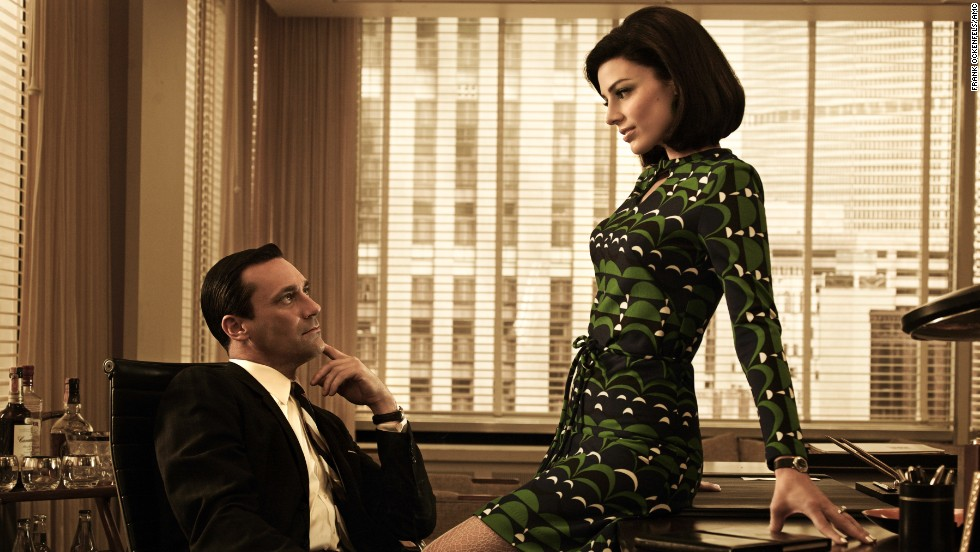 "Don and Megan Draper, played by Jessica Pare, in season 5 of ""Mad Men,"" set in 1966-67. Megan starts as a secretary and becomes Don's wife."