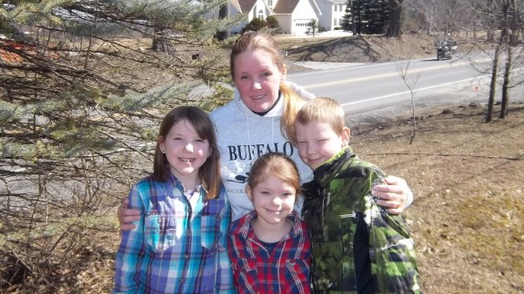 Tracy Scarpulla and her three children, Emma, Georgia and Remmington, outside of their home.