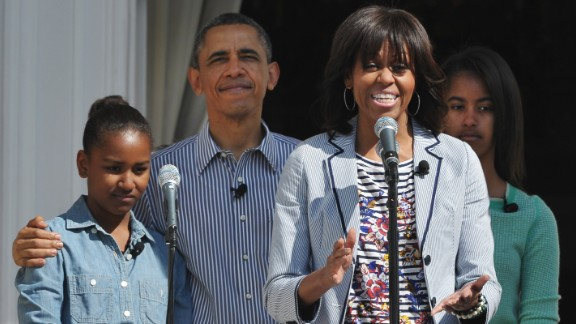 First lady Michelle Obama speaks as her family, Sasha, left, President Barack Obama, and Malia listen at the start of the annual event.