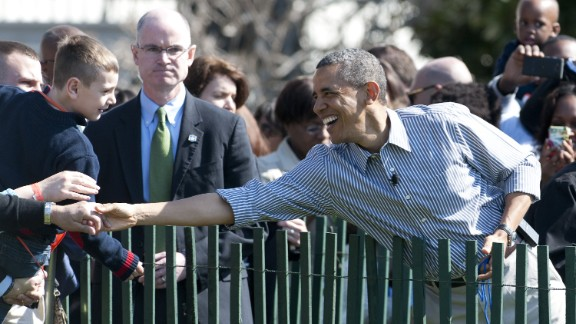 Obama greets guests.