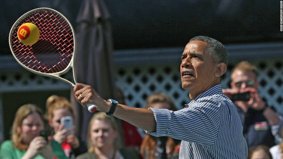 Obama plays tennis with children.