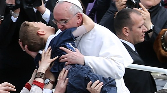 VATICAN CITY, VATICAN - MARCH 31: Pope Francis embraces a boy prior to his first 'Urbi et Orbi' blessing from the balcony of St. Peter's Basilica during Easter Mass on March 31, 2013 in Vatican City, Vatican. Pope Francis delivered his message to the gathered faithful from the central balcony of St. Peter's Basilica in St. Peter's Square after his first Holy week as Pontiff. (Photo by Franco Origlia/Getty Images)