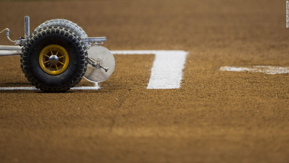 The lines are painted on the field before the start of the Brewers-Rockies game.
