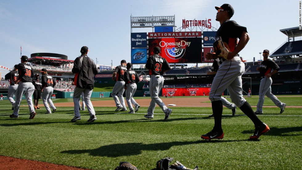 Members of the Miami Marlins warm up on the field before the game against the Washington Nationals.