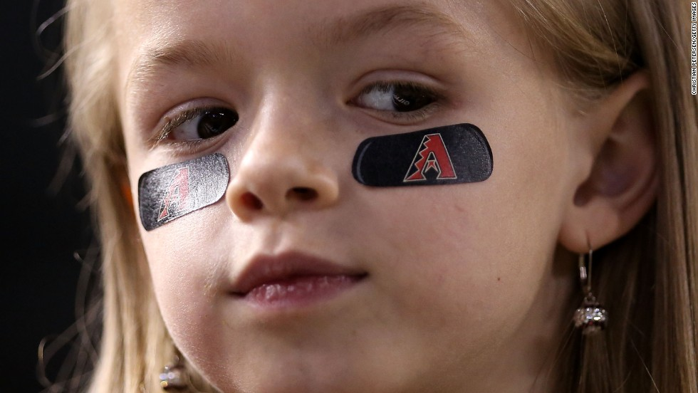 A young Arizona Diamondbacks fan watches the action against the Cardinals.