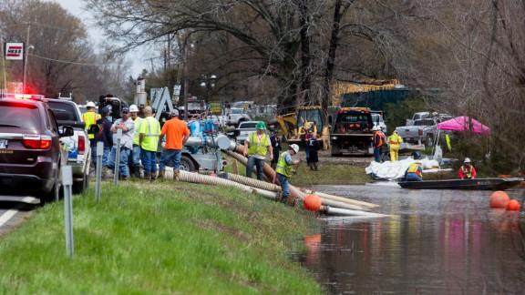 Emergency crews work near Interstate 40 on March 31.