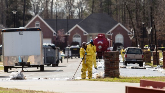 Crews clean up in front of evacuated homes on Starlite Road in Mayflower.