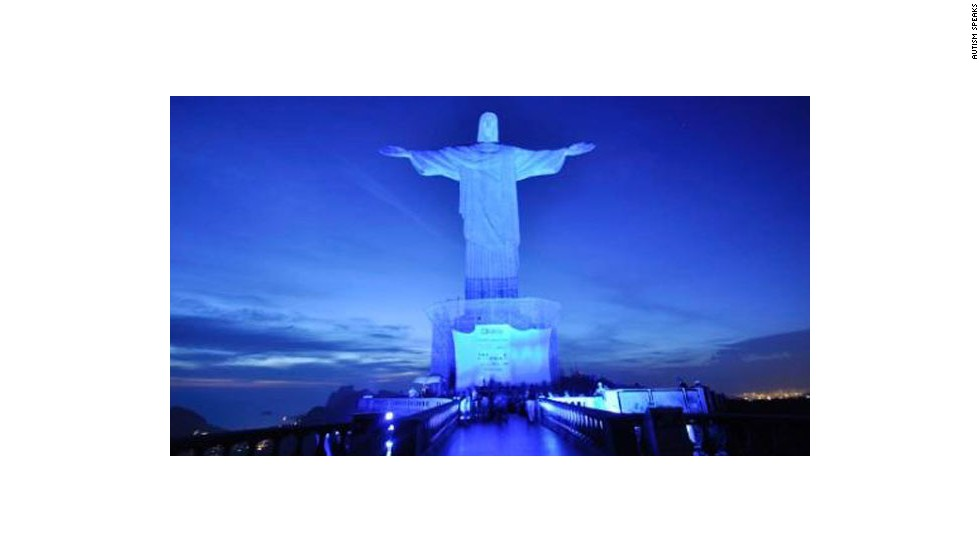 The Christ the Redeemer statue in Rio de Janeiro is illuminated for the 2012 World Autism Awareness Day.