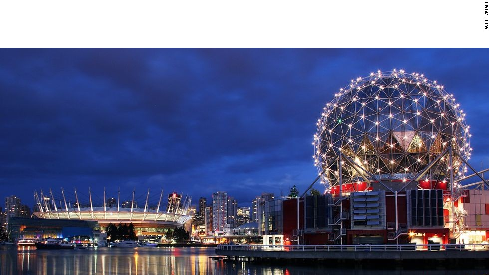 The Telus World of Science building, right, in Vancouver, Canada, lights up for the 2012 World Autism Awareness Day.