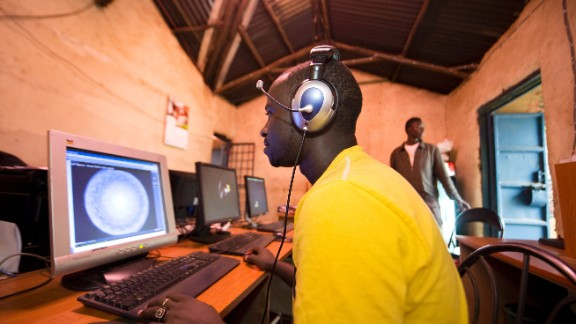 Surfing the internet at a cyber cafe in Nairobi, Kenya.