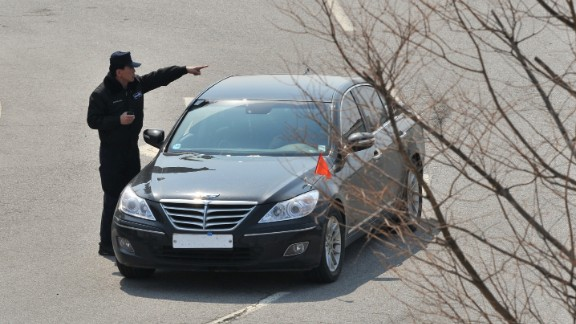 An officer directs a South Korean car that was denied access at a military checkpoint in Paju.
