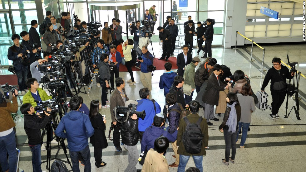 Reporters gather in front of customs at the Inter-Korean Transit Office in Paju in April.