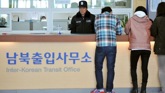 South Koreans stand in front of an information desk at the Inter-Korean Transit Office in Paju after being blocked from North Korea in April.