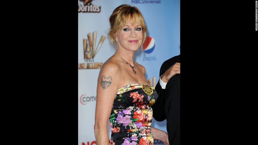 "Melanie Griffith showed off her ""Antonio"" tattoo, honoring husband Antonio Banderas, at the 2011 American Latino Media Arts Awards. But with the actress filing for divorce in 2014, <a href=""http://www.tmz.com/2014/06/23/melanie-griffith-antonio-banderas-tattoo-divorce-photoshop/"" target=""_blank"">it looks like the tattoo outlasted the marriage.</a>"