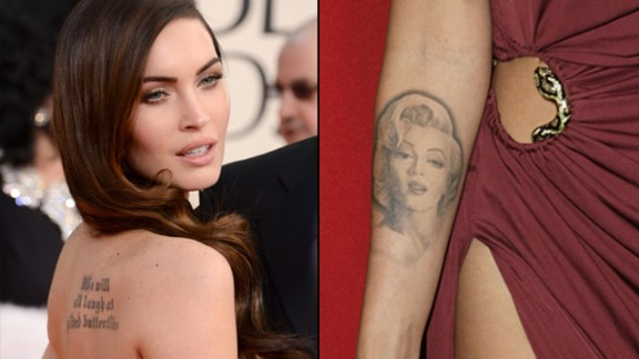 "Megan Fox has two prominent tattoos. Shakespeare's ""We will all laugh at gilded butterflies"" is inked on her back, and she used to sport a picture of Marilyn Monroe on her forearm."