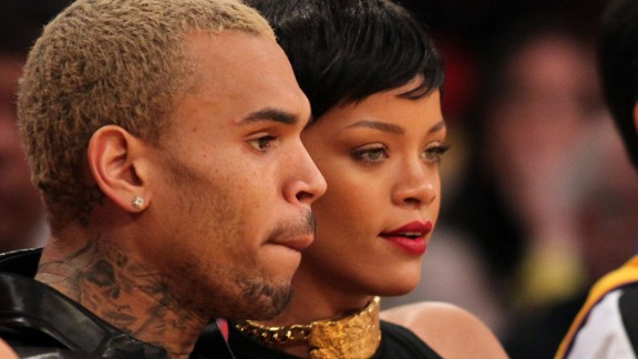 "Chris Brown, shown here with Rihanna in December 2012, took heat when he debuted a tattoo on his neck that some people thought resembled a battered woman's face. ""His tattoo is a sugar skull (associated with the Mexican celebration of the Day of the Dead) and a MAC cosmetics design he saw,"" his rep said in a statement. ""It is not Rihanna or an abused woman as erroneously reported."""