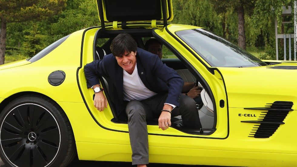 Germany coach Joachim Loew gets out of a Mercedes SLS AMG E-Cell in another sponsorship event.