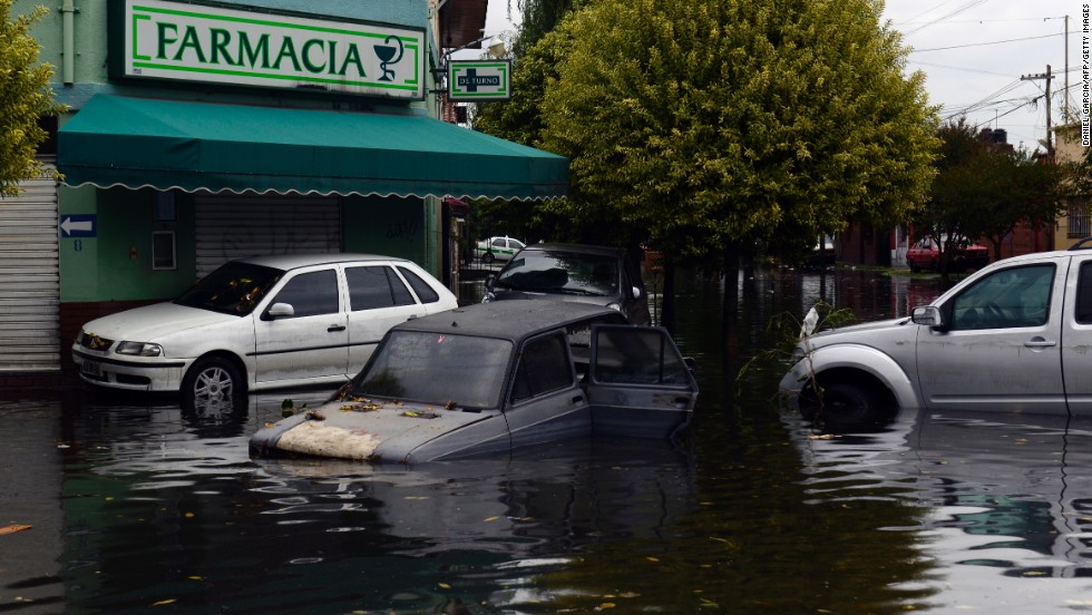 Partially submerged cars are seen outside a pharmacy in La Plata on April 3.