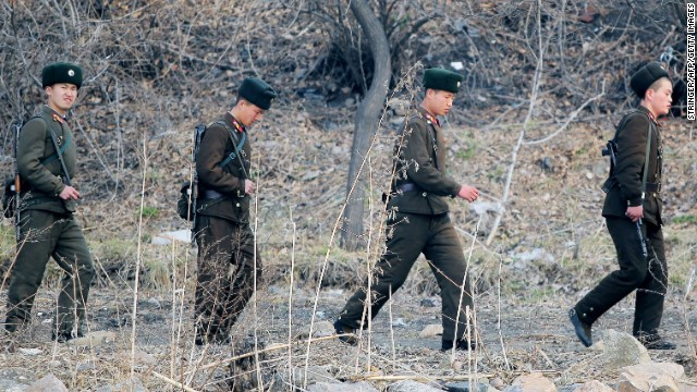 North Korean soldiers patrol along the bank of the Yalu River in the North Korean town of Sinuiju across from the Chinese city of Dandong on April 4, 2013.