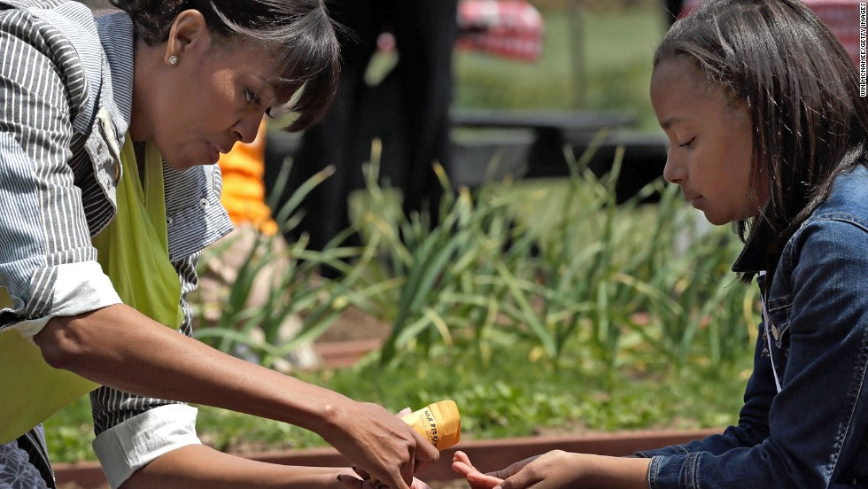 Obama shares a packet of seeds with Ariana Docanto of Somerville, Massachusetts.
