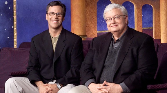 """Chicago Sun-Times columnists Richard Roeper, left, and Ebert  promote their television series """"Roger Ebert & the Movies"""" in this undated photo."""
