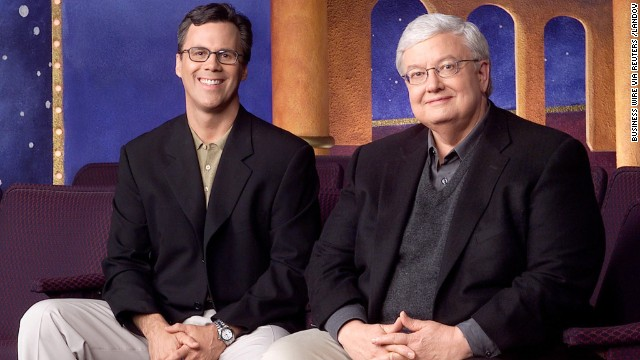 "Chicago Sun-Times columnists Richard Roeper, left, and Roger Ebert pose for a photo to promote their television series ""Roger Ebert & the Movies."""