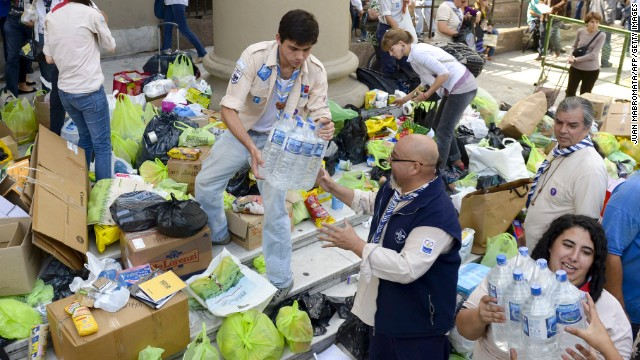 Volunteers load a truck with donated supplies in front of the Metropolitan Cathedral in Buenos Aires on Thursday, April 4. Rescuers were still searching for people missing in nearby La Plata after the storm.