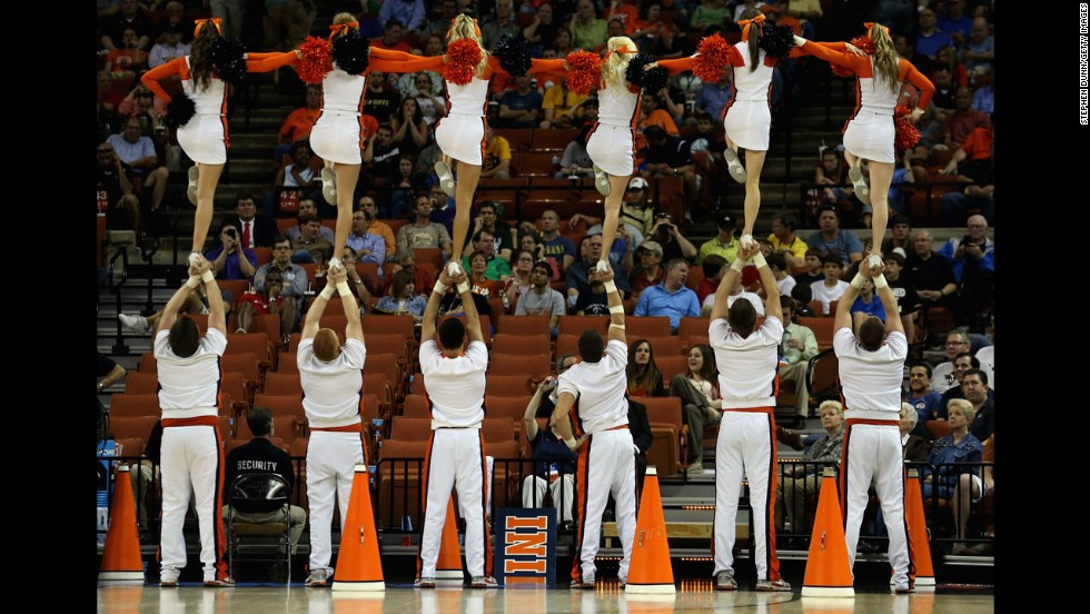 Illinois Fighting Illini cheerleaders perform during a game against the Colorado Buffaloes on March 22 in Austin, Texas.