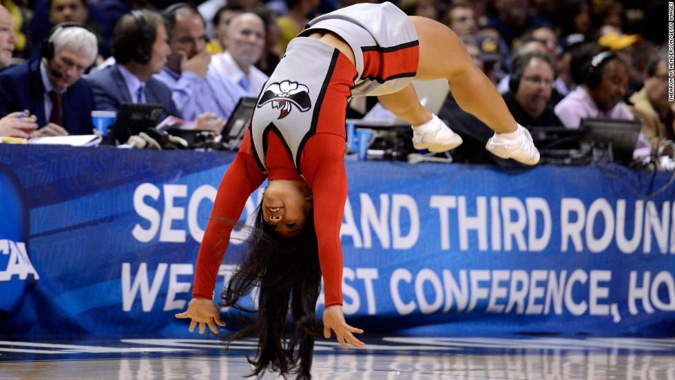 A University of Nevada Las Vegas Rebels cheerleader does a flip during game stoppage on March 21 in San Jose.