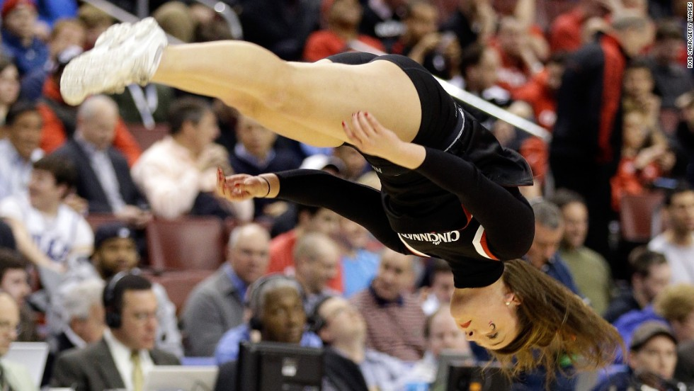A Cincinnati Bearcats cheerleader performs in the first half during a break in the game against the Creighton Bluejays on March 22 in Philadelphia.