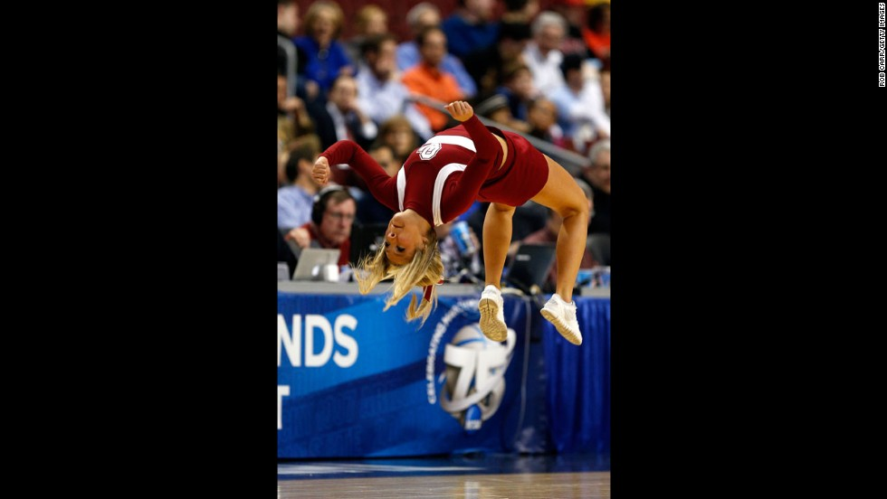 A cheerleader for the Oklahoma Sooners backflips on March 22 in Philadelphia.