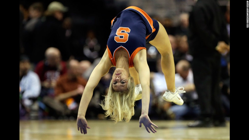 A Syracuse Orange cheerleader performs on March 28 in Washington.