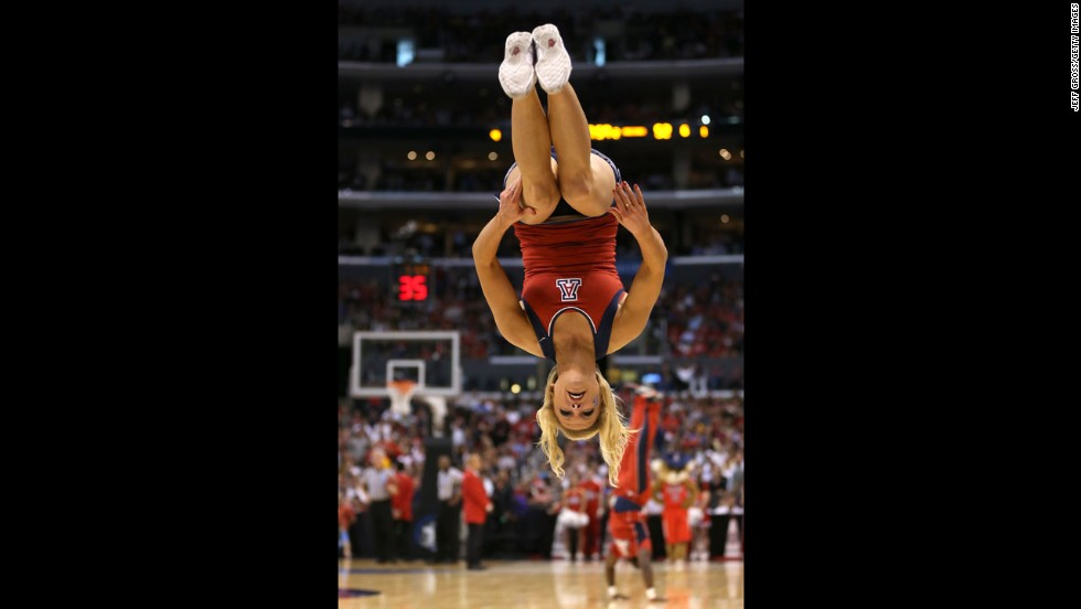 An Arizona Wildcats cheerleader performs during a break in a game against the Ohio State Buckeyes on March 28 in Los Angeles.