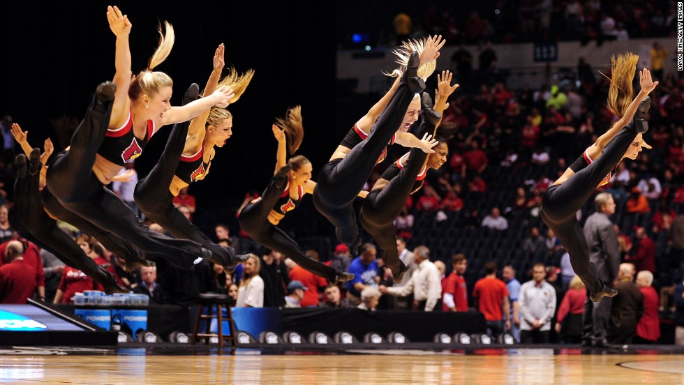 Louisville Cardinals cheerleaders perform during a game against the Duke Blue Devils on March 31 in Indianapolis. Click through to see more NCAA cheerleaders jumping and tumbling through March Madness.