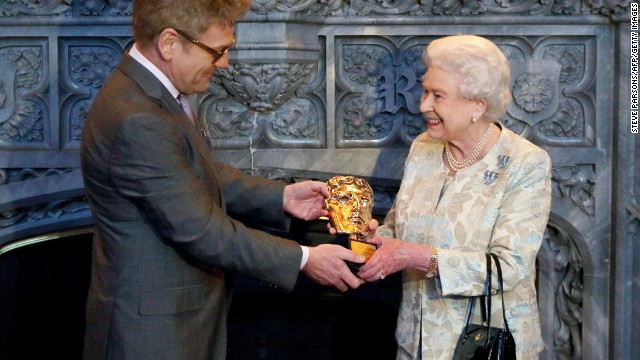 Queen Elizabeth II receives an honorary Bafta from actor and director Kenneth Branagh in recognition of a lifetime's support of British film and television on April 4, 2013.
